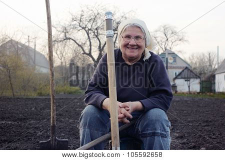 Laughing Grandmother In Garden