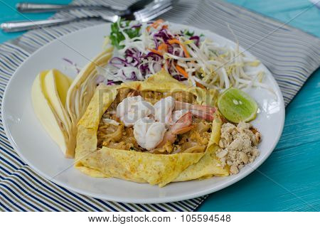 Thai Food Pad Thai , Stir Fry Noodles With Pork.wrap Eggs On White Plate Decorated With Various Seas