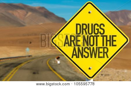 Drugs Are Not the Answer sign on desert road