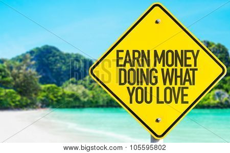 Earn Money Doing What You Love sign with beach background