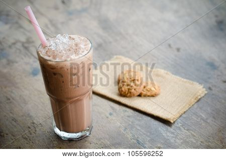 Iced Cocoa In A Glass On Wood Background