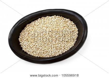 Quinoa grains in black bowl.  Overhead view, isolated on white.