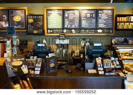 SHENZHEN, CHINA - OCTOBER 13, 2015: Starbucks Cafe interior. Starbucks Corporation is an American global coffee company and coffeehouse chain based in Seattle, Washington