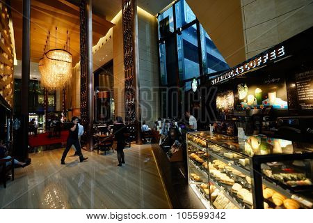 SHENZHEN, CHINA - OCTOBER 15, 2015: Starbucks Cafe interior. Starbucks Corporation is an American global coffee company and coffeehouse chain based in Seattle, Washington