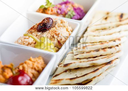 Harissa hummus feta ajvar and pita bread