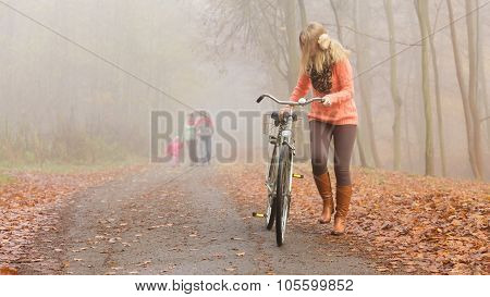 Active Woman Riding Bike Bicycle In Autumn Park.