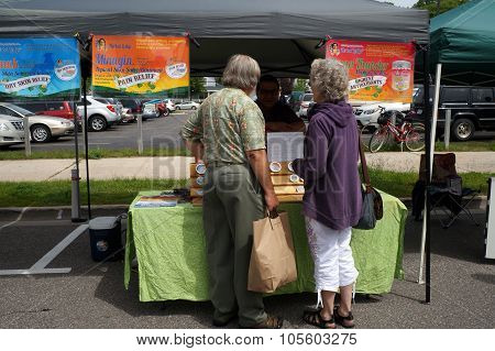 Shoppers at the Herbal Lodge Stand