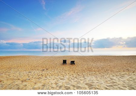 The Beach Chairs On Sand Beach During Sunrise Or Sunset