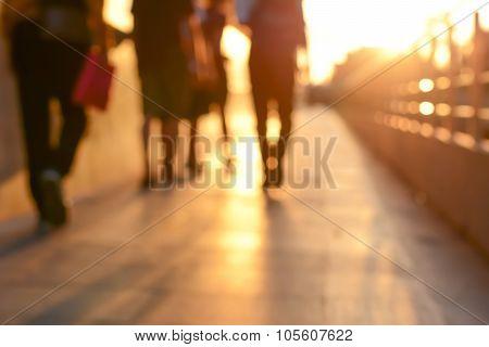 Blur Silhouette Of People Walking On Walkway In Twilight