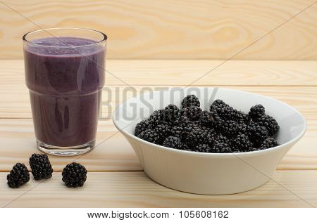 Smoothie From Blackberries  In A Glass And Blackberries  On Wooden Table