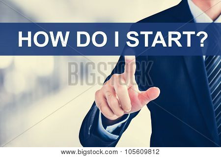 Businessman Hand Touching How Do I Start? Tab On Virtual Screen