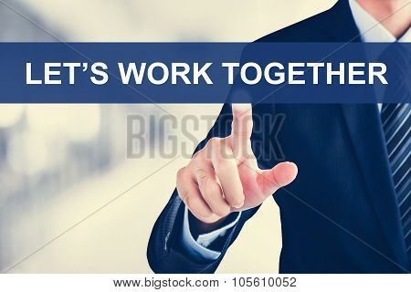Businessman Hand Touching Let's Work Together Message On Virtual Screen