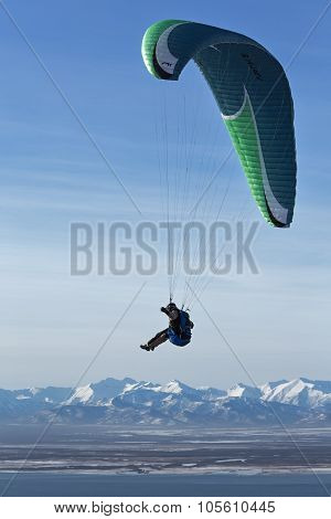 Paraglider Flying On Background Of Mountain And Sea