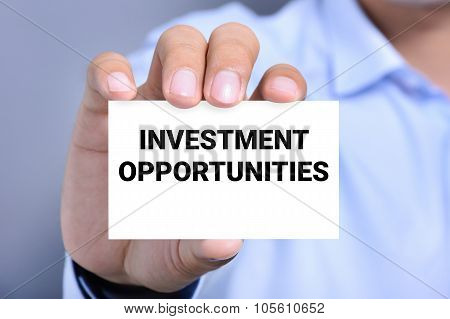 Investment Opportunities Message On The Card Held By A Man Hand