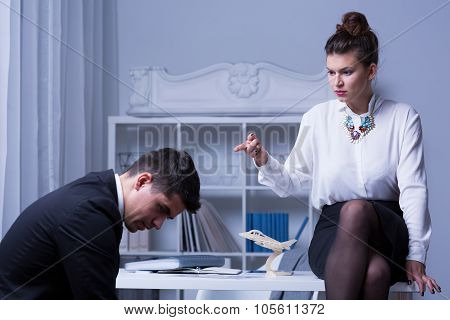 Female Leader Humiliating Male Worker