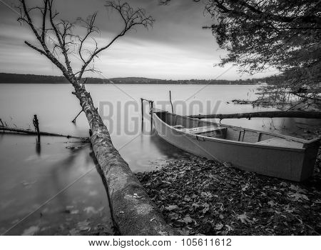 Lake Shore With Moored Boat. Long Exposure