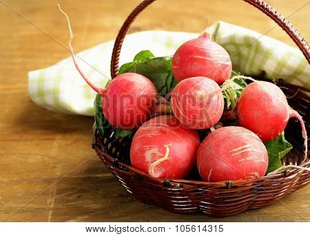 Fresh organic radishes on a wooden table