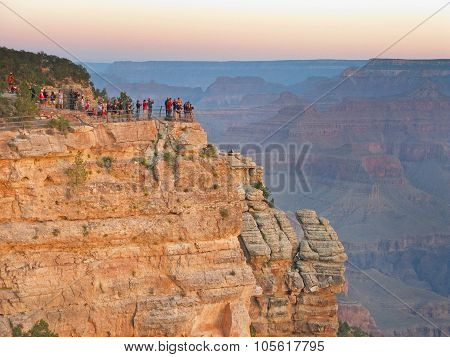 Tourists standing on a cliff