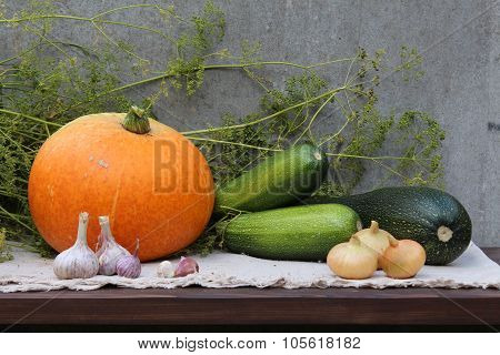 A harvesting time. A pumpkin, the marrows, the garlics, the onions.