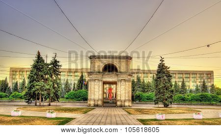 The Triumphal Arch And The Government Building In Chisinau - Moldova