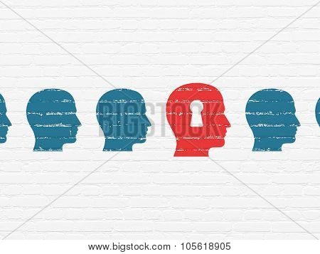 Education concept: head with keyhole icon on wall background