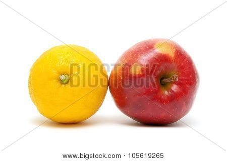 Red Apple And Lemon Close Up On A White Background