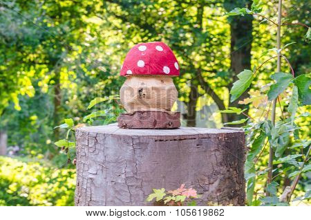 Fly Agaric On Tree Trunk