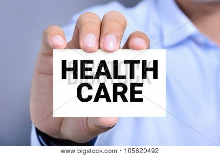 Health Care Message On The Card Shown By A Man