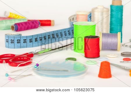 Sewing kit, Scissors, bobbins with thread, measure tape and needles