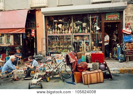 Antique Market And People Drinking Tea Near Vintage Furniture Store