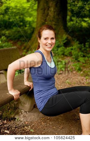 Young smiling woman doing her  exercise