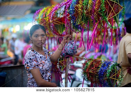 HANOI, VIETNAM - SEPTEMBER 6, 2015: Street vendors sell lantern in street in mid-autumn festival in Hanoi ancient town. Parents often buy lanterns for their children in this occasion.