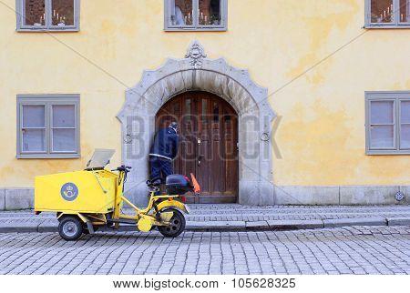 The Unidentified Postman Brings Post In Vasteras City In Sweden