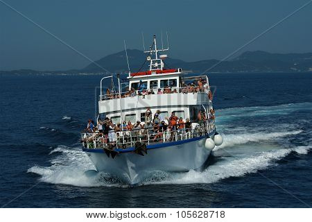 Corfu - July 10: A Cruises Tour Boat Sails From Corfu Island Towards Paxos Island On July 10, 2008 O