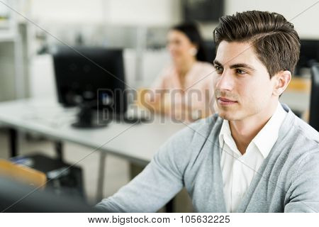 Young Handsome Man Studying Information Technology In A Classroom