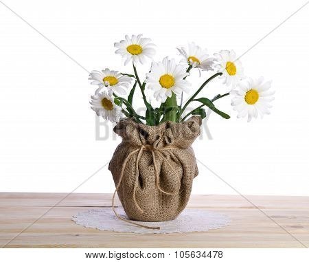Beautiful Bouquet Of  Camomile Flowers In Flowerpot  On The Wooden Table