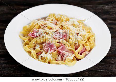 Pasta carbonara with tagliatelle spaghetti with bacon, egg york