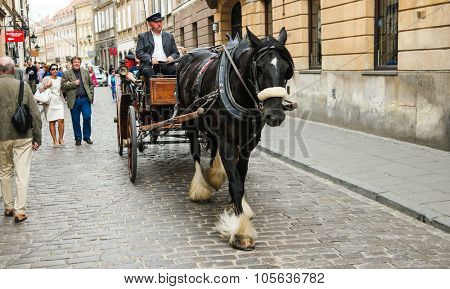 Warsaw, Poland - 8 March 2015:  carriage on Warsaw street in historic part of the city