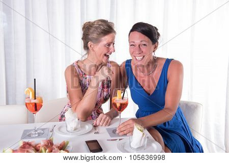 Two Attractive Women Giggeling Together