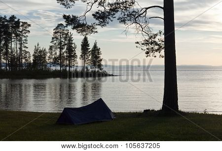 Camping in a tent close to a lake