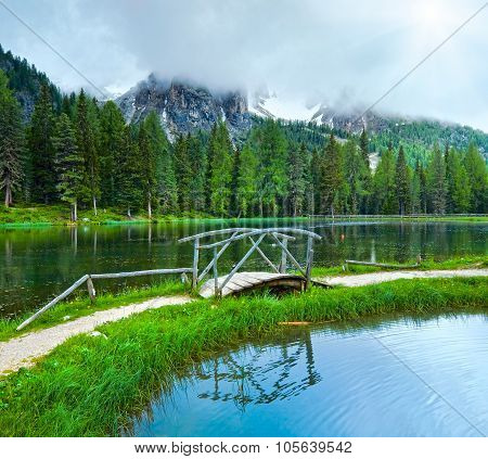Alpine Summer Lake And Sunshine Through Cloudy Sky