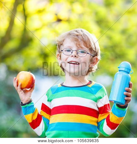 Little School Boy With Books, Apple And Drink Bottle