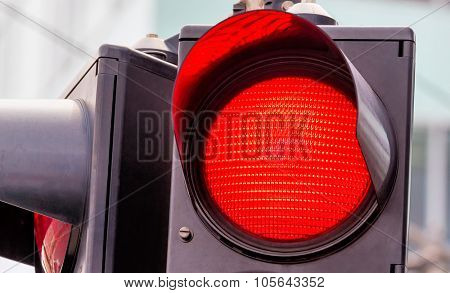 a traffic light shows red light. symbolic photo for grip end.