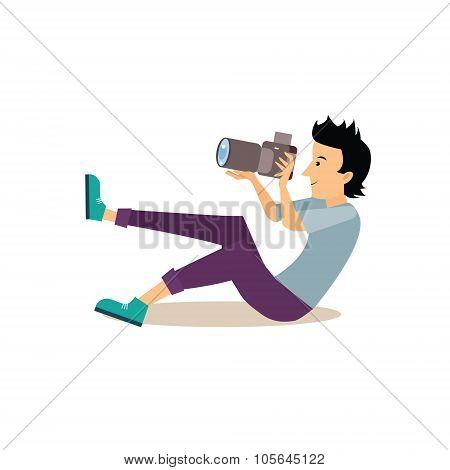 Sitting Photographer in Flat Style. Vector Illustration
