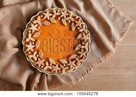 Traditional pumpkin tart pie healthy sweet dessert recipe, decorated on top. Thanksgiving day organi