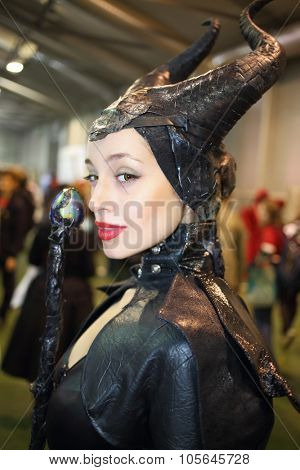 MOSCOW - OCT 12, 2014: Portrait of girl in a black suit Maleficent at the EveryCon 2014 in the exhibition center Sokolniki