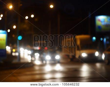 Defocused Image Of Night Traffic On City Street