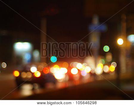 Defocused Image Of Traffic On Night City Street