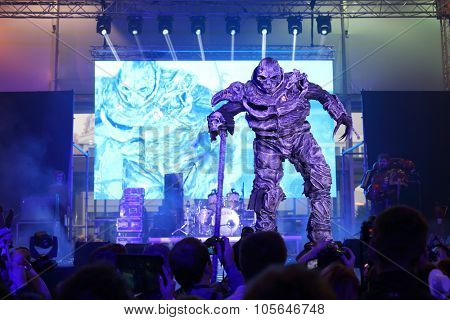 MOSCOW - OCT 12, 2014: Performances of cosplayer dressed stone monster EveryCon 2014 on the stage in the exhibition center Sokolniki