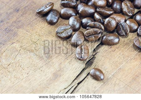 Coffee Beans  Texture  On The Wood Background
